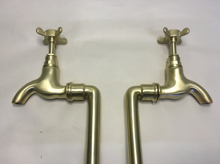Bib taps on stands in Brushed brass.