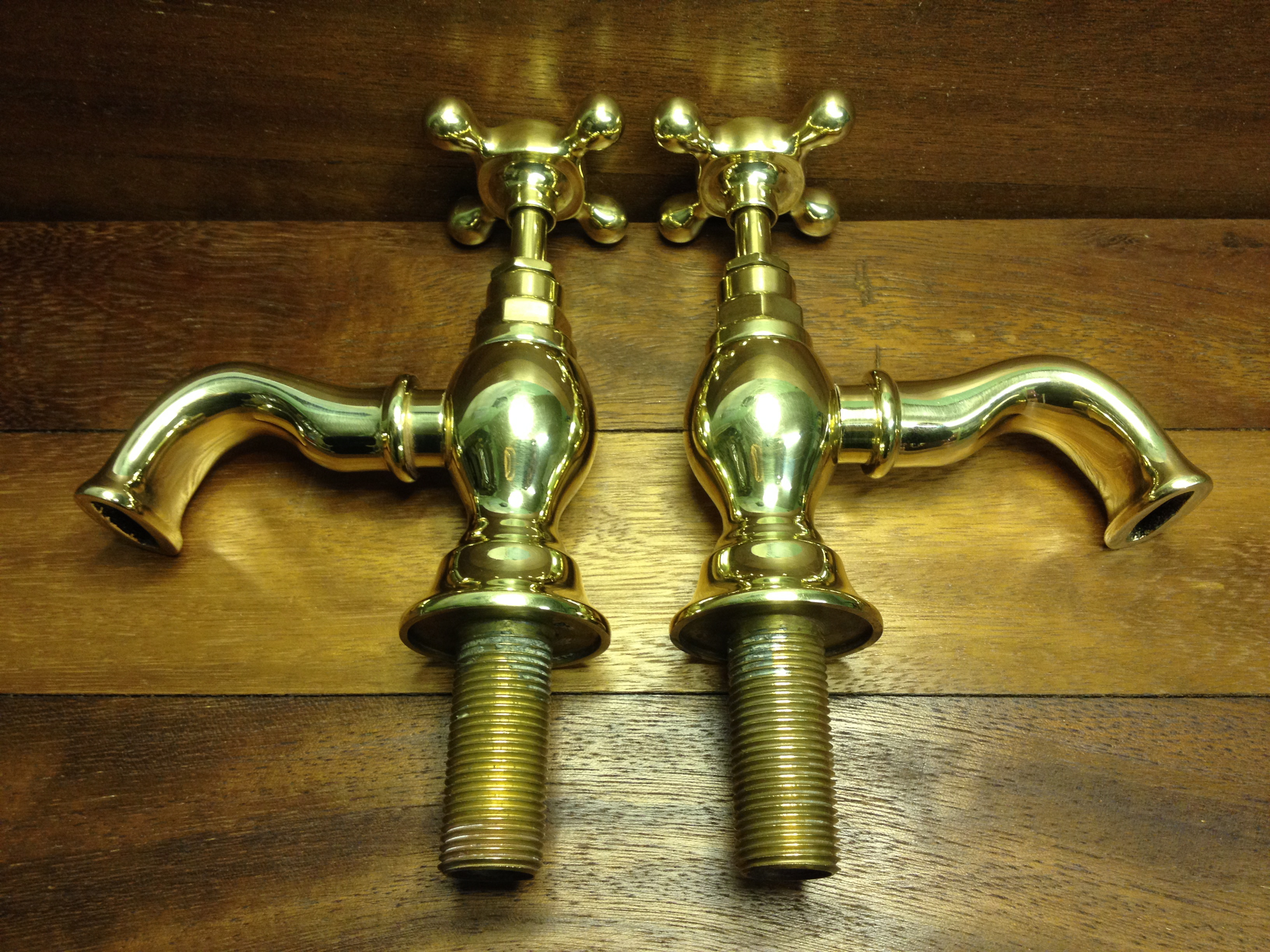Curvaceous spouts on basin taps