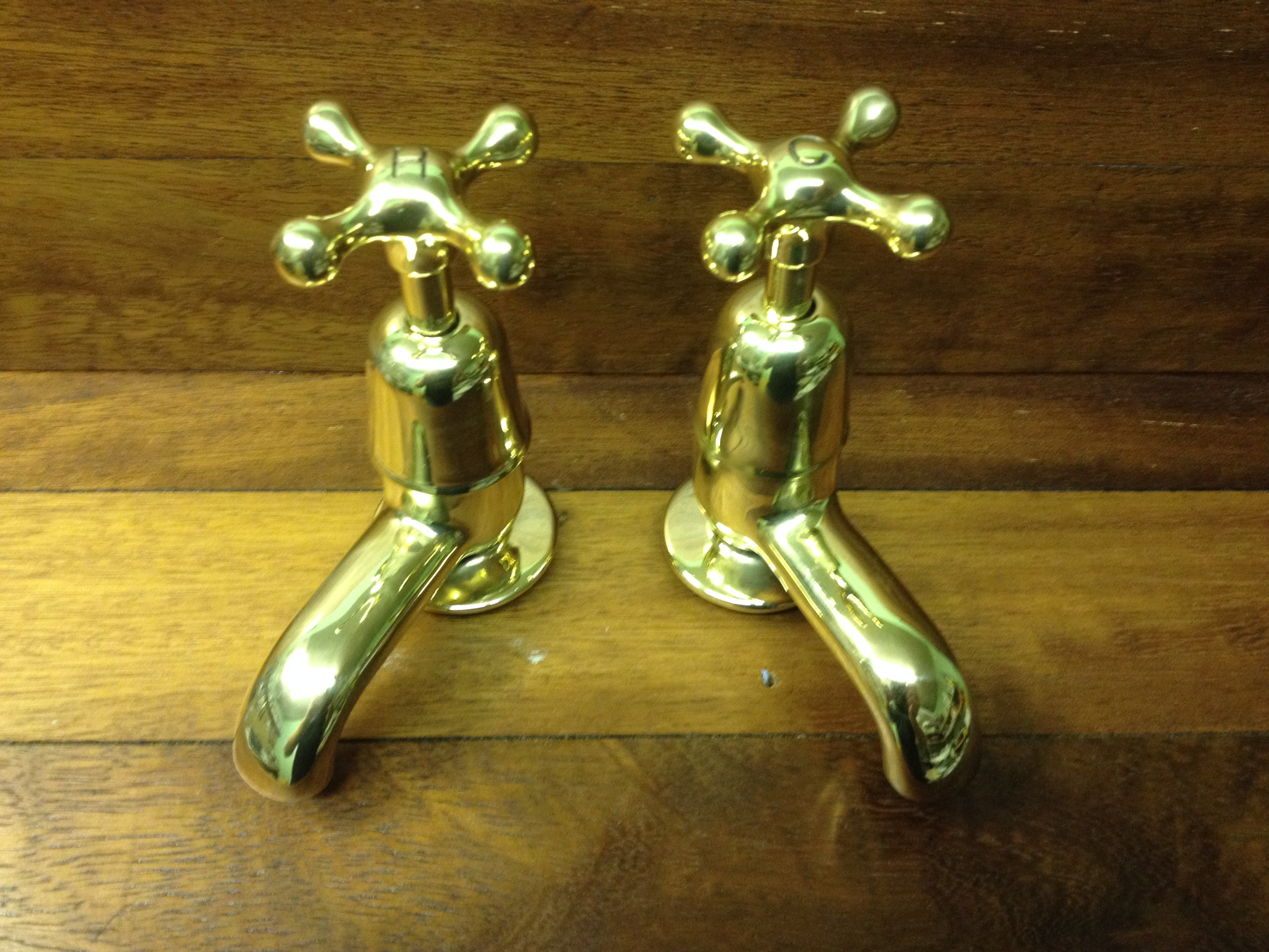 Stamped indices on brass basin taps.