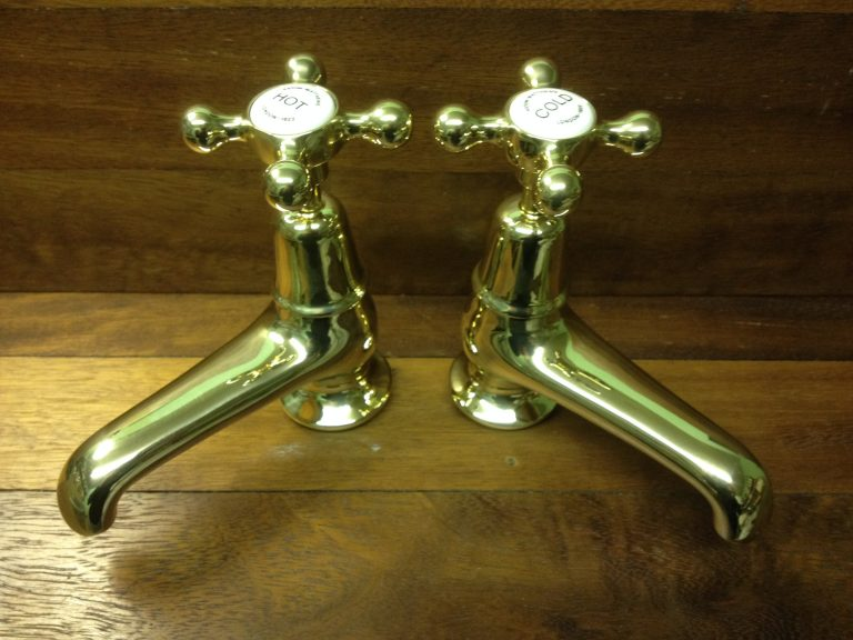 "Polished brass 4"" basin taps by Aston Matthews"